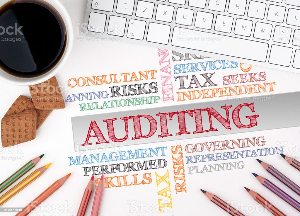 AUDITING word cloud. White office desk stock photo