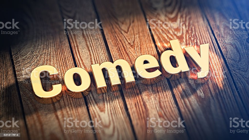 Word Comedy on wood planks stock photo
