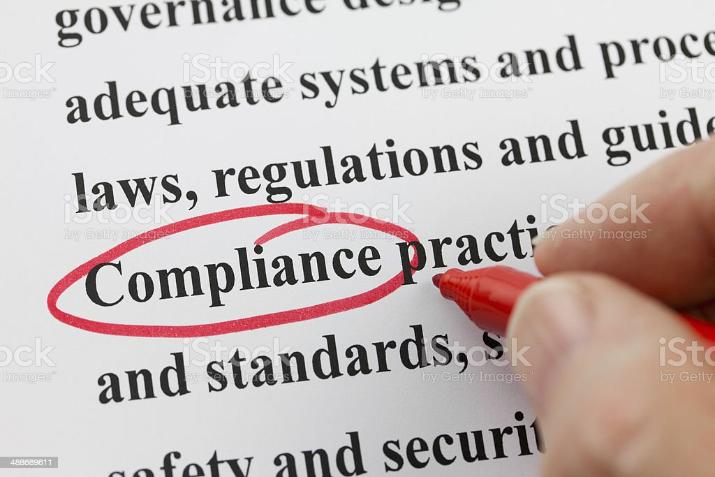 Word Compliance Circled by Hand with Red Pen stock photo