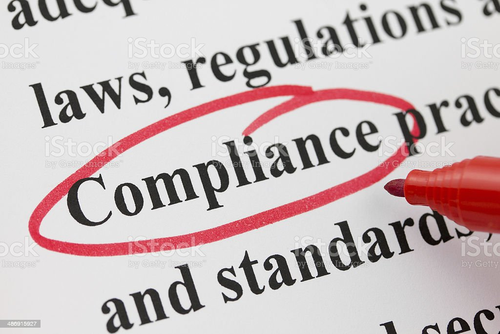 Word Compliance Circled in Red Pen Closeup stock photo