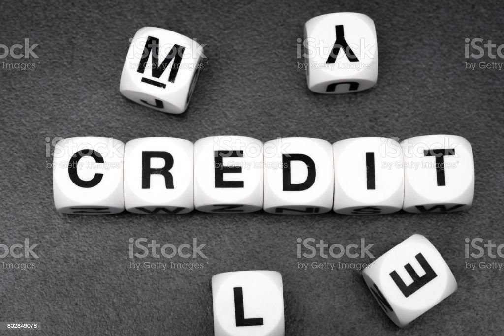 word credit on toy cubes stock photo