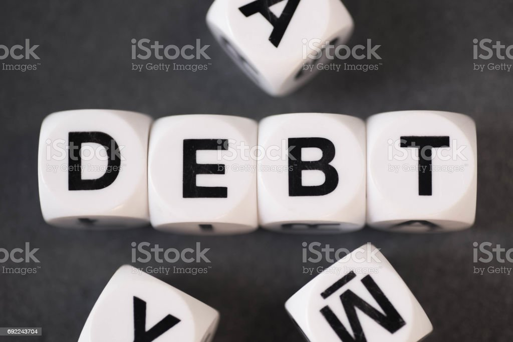 word debt on toy cubes stock photo