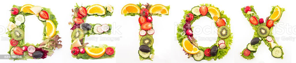 Word detox made of salad and fruits stock photo