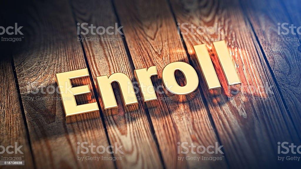 Word Enroll on wood planks stock photo
