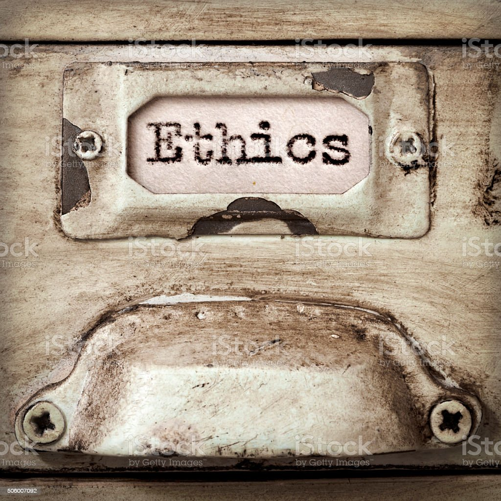 Word Ethics on Vintage Filing Cabinet Drawer Label stock photo