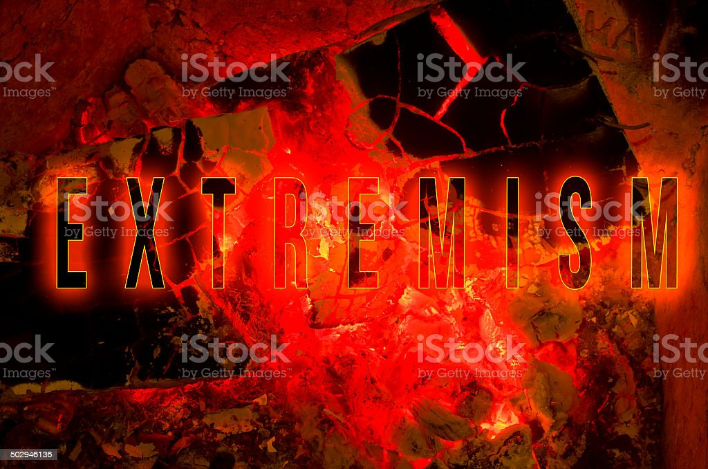 Word extremism written on red hot wood embers detail stock photo