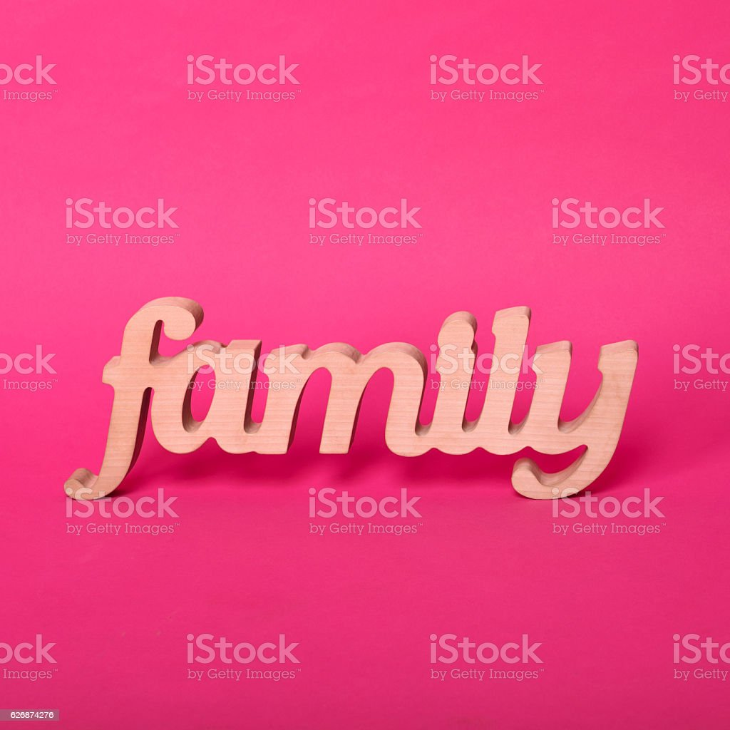 Word family, wooden letters on pink paper background. Love and stock photo
