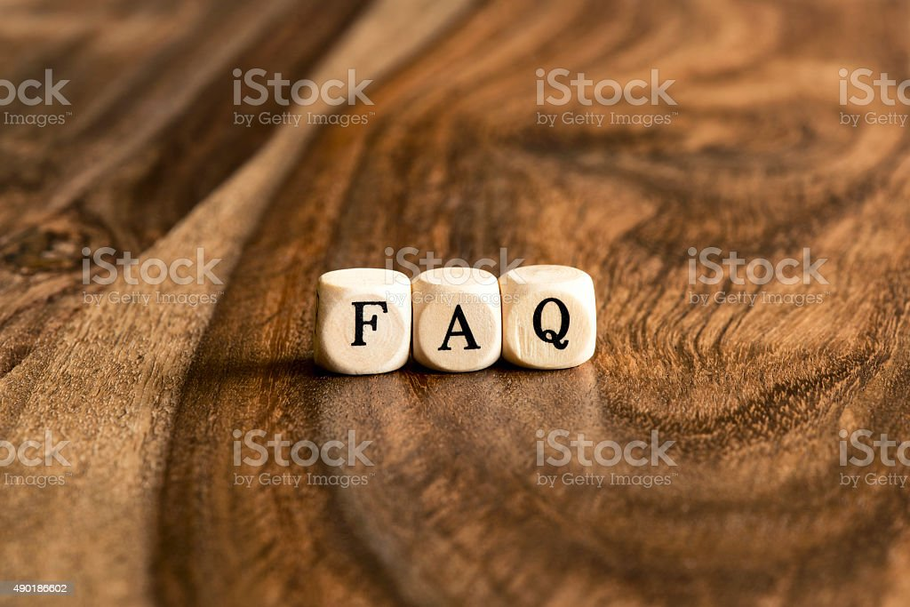 Word FAQ on wooden cubes stock photo