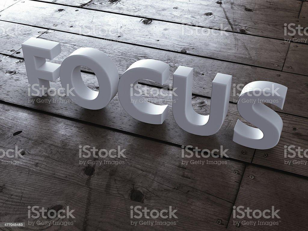 Word focus on wooden floor royalty-free stock photo