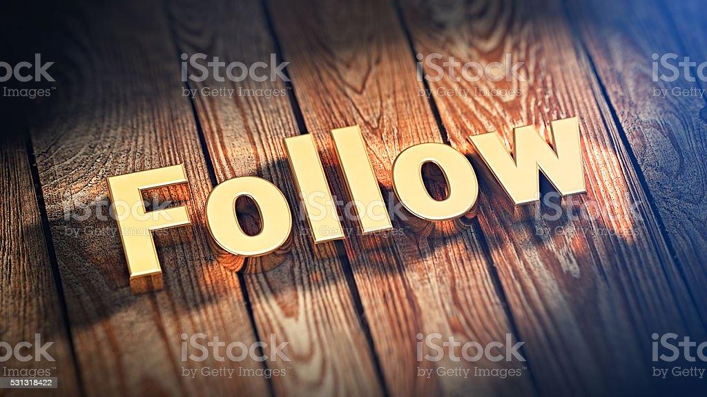 Word Follow on wood planks stock photo
