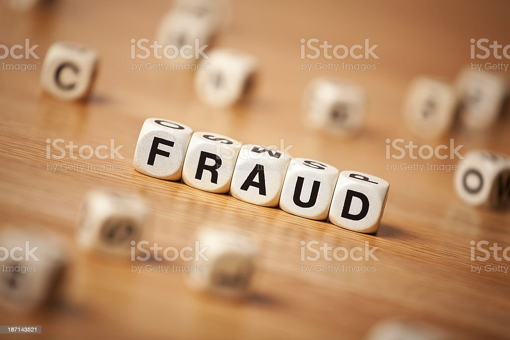 Word FRAUD Spelled In Letter Cubes stock photo