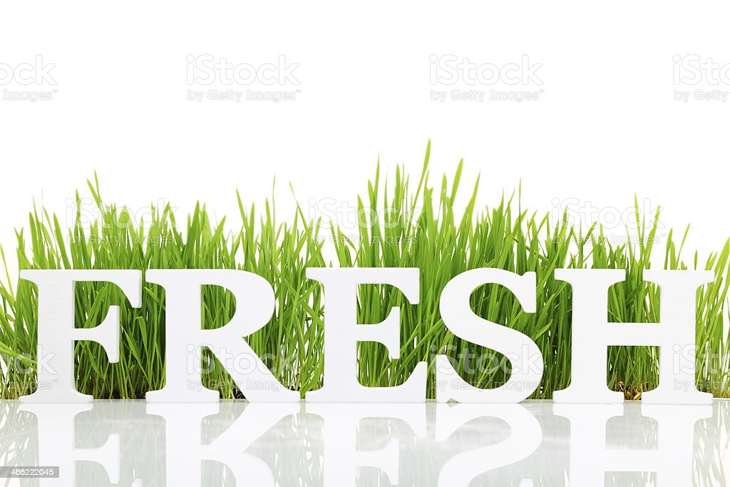 Word 'Fresh' with fresh grass isolated on white stock photo