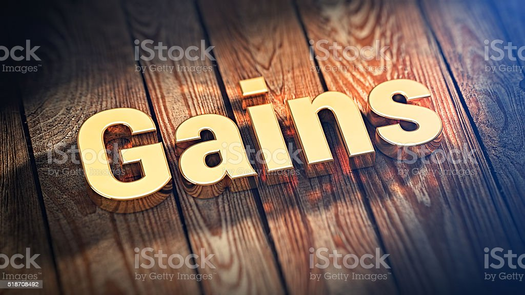 Word Gains on wood planks stock photo