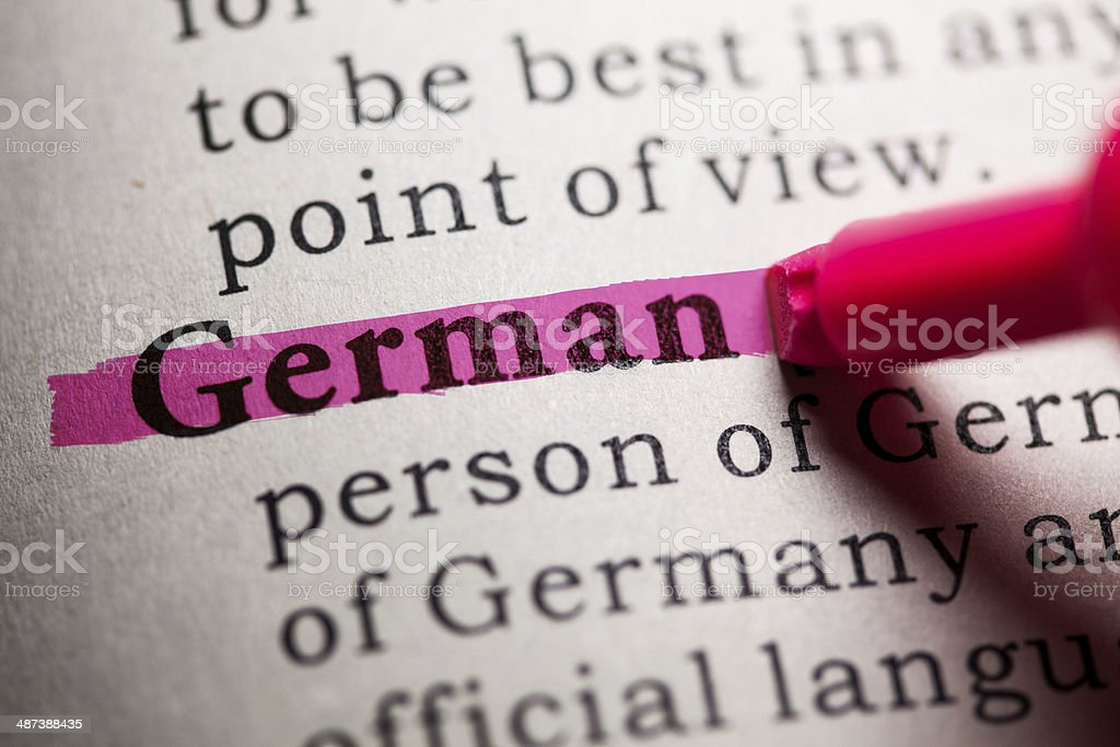 Word 'German' highlighted in dictionary royalty-free stock photo
