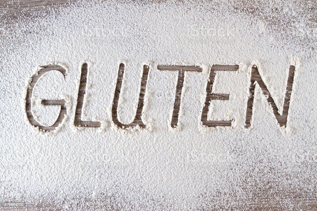 Word Gluten Written on Flour stock photo