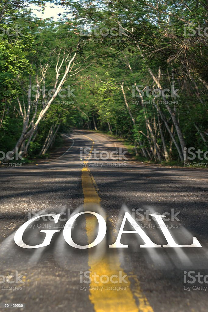 Word GOAL on the road.  Road in the forrest royalty-free stock photo