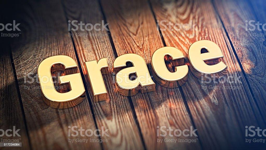 Word Grace on wood planks stock photo