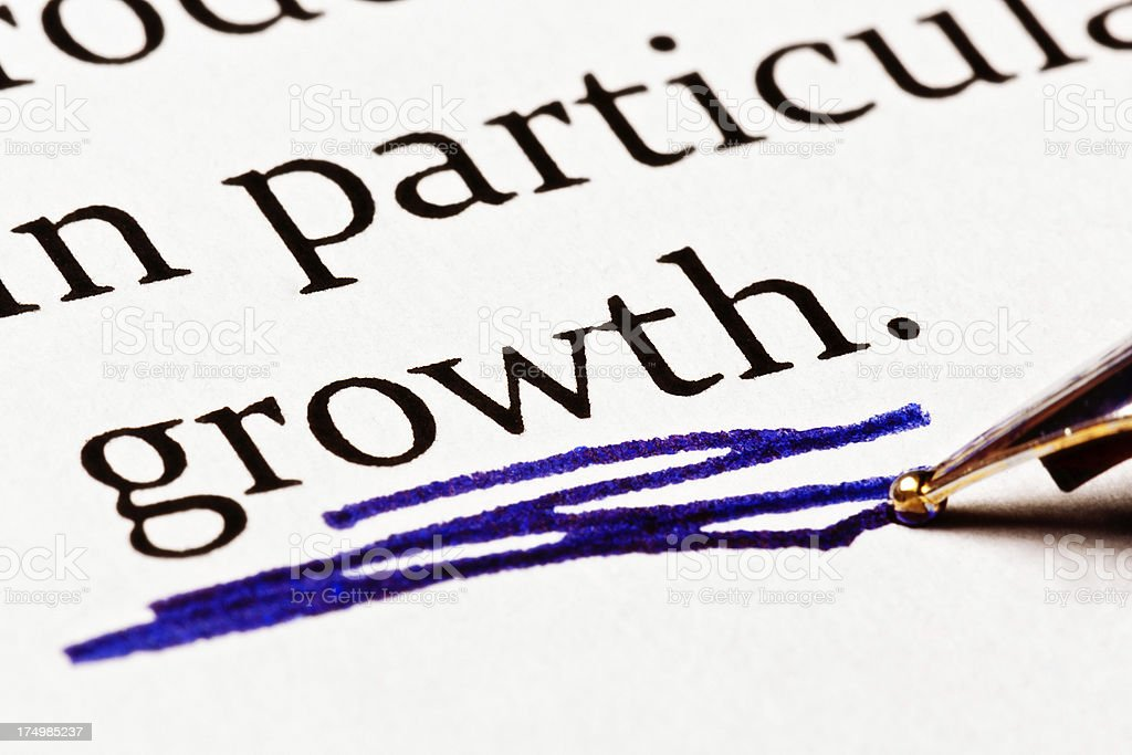 Word 'Growth' emphasized in a document with heavy blue underlining royalty-free stock photo