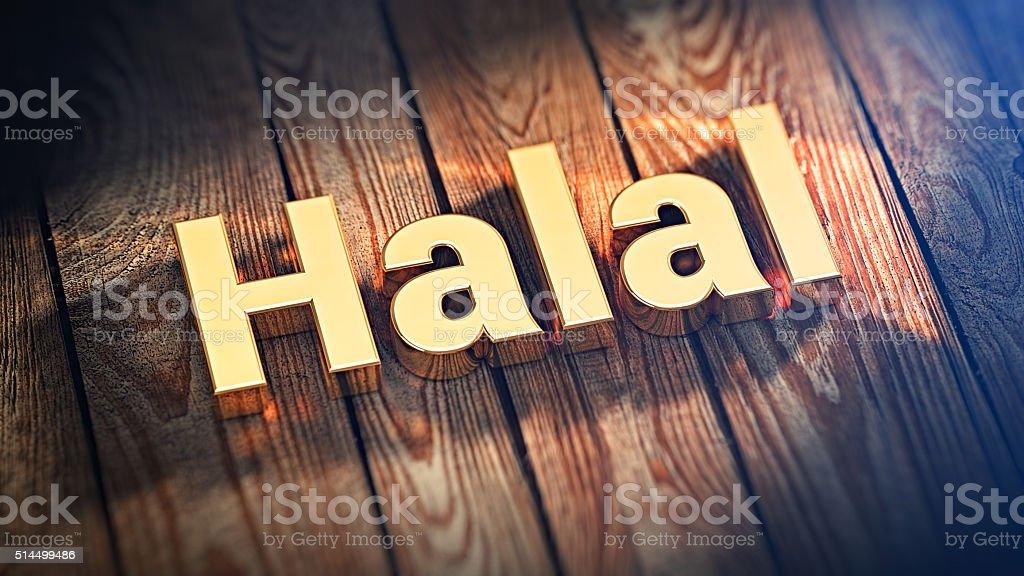 Word Halal on wood planks stock photo