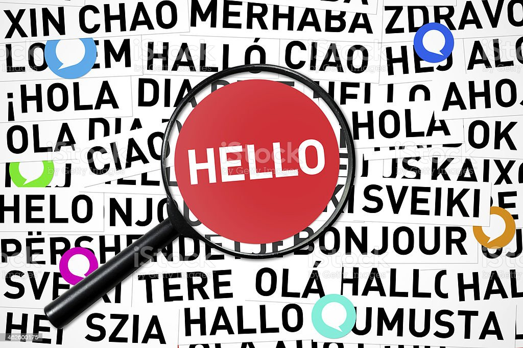 Word Hello inside a magnifying glass in different languages stock photo