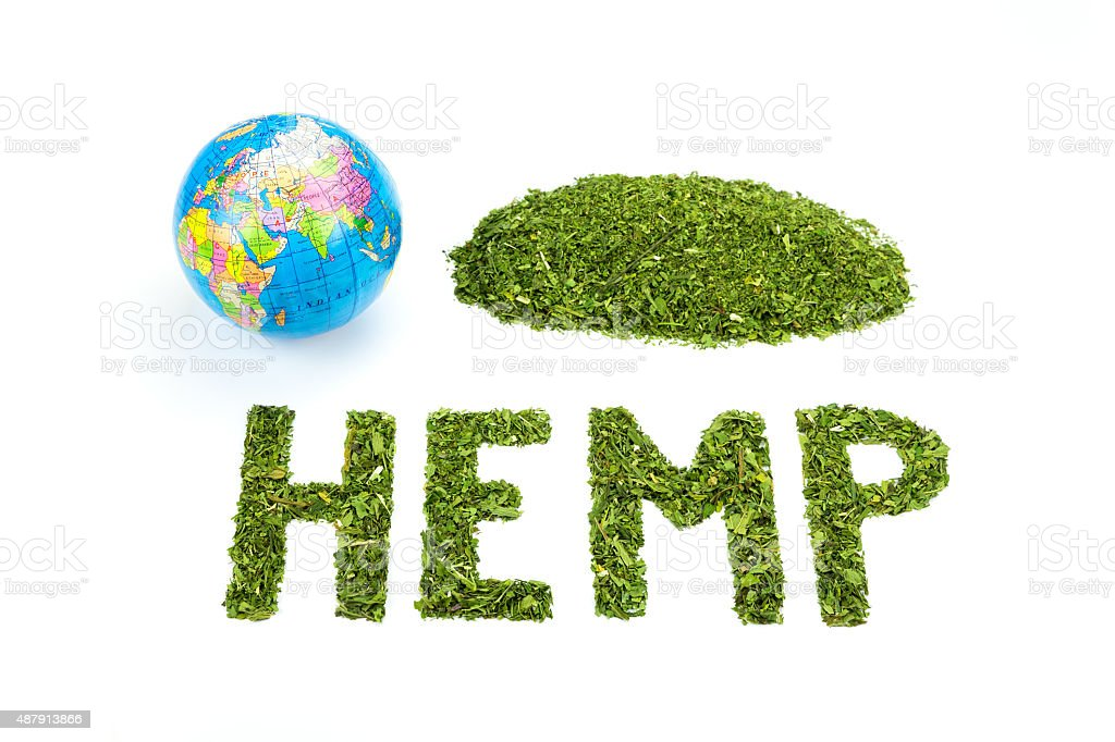 Word HEMP made of green tea leaves with world globe stock photo