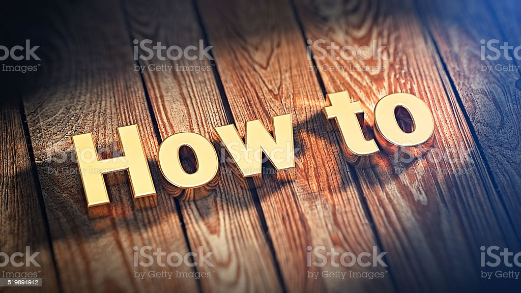 Word How To on wood planks stock photo