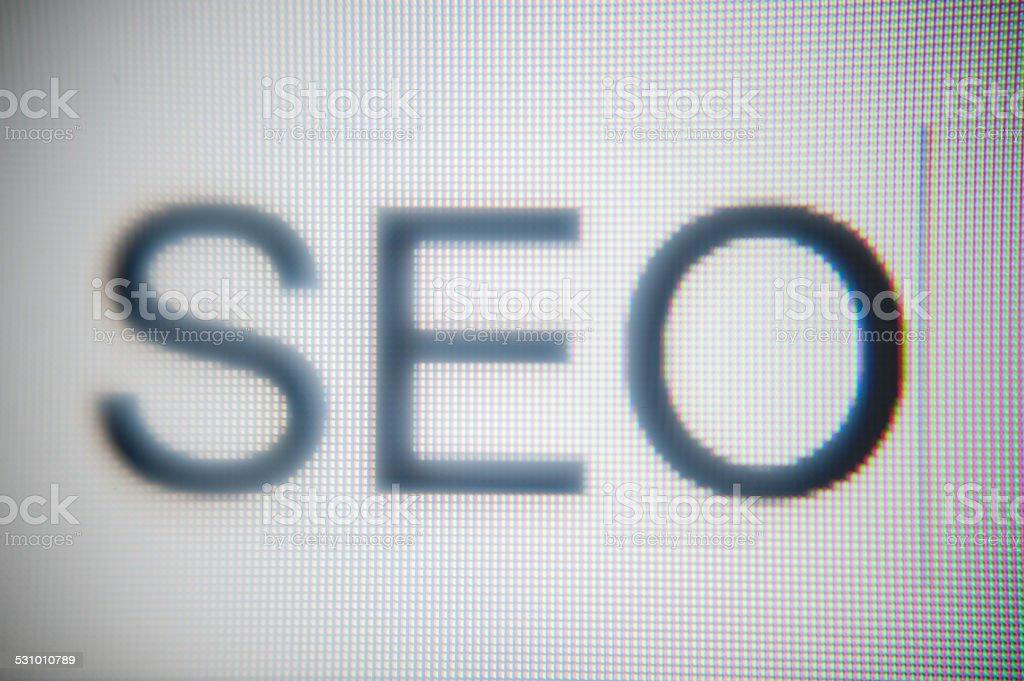 SEO word in search bar macro stock photo