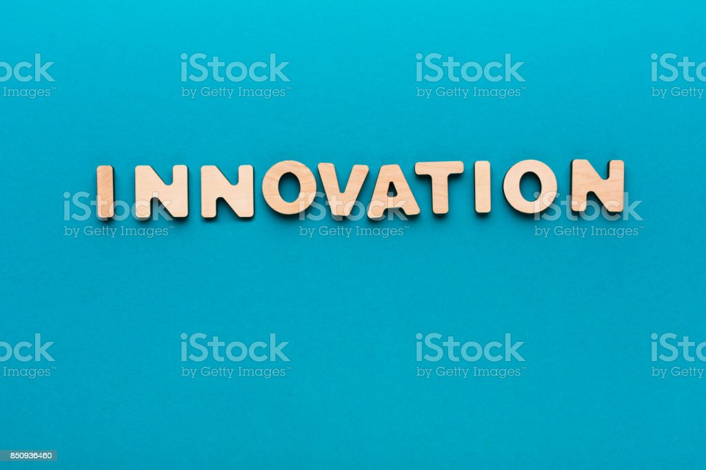 Word Innovation on blue background stock photo
