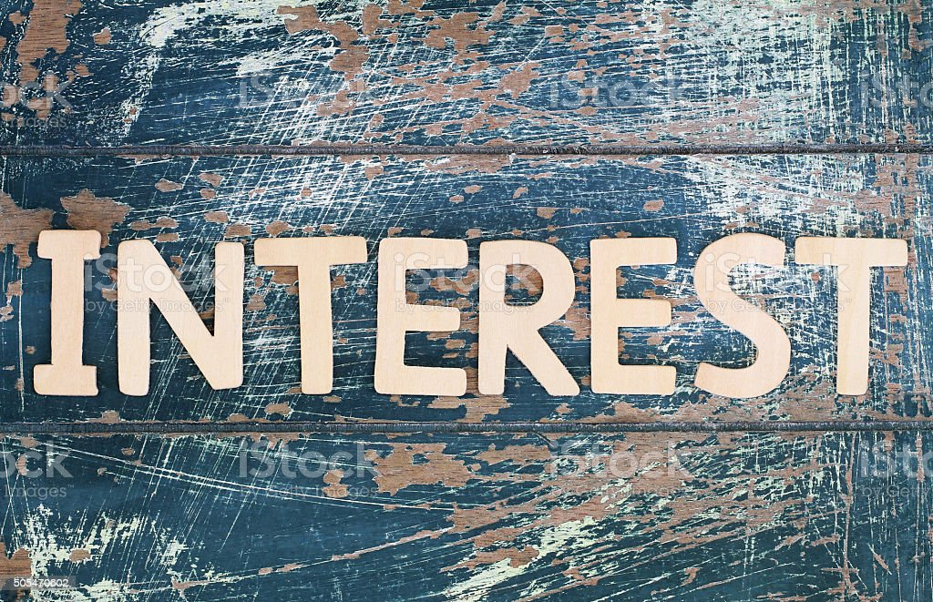 Word interest written with wooden letters on rustic wooden surface stock photo