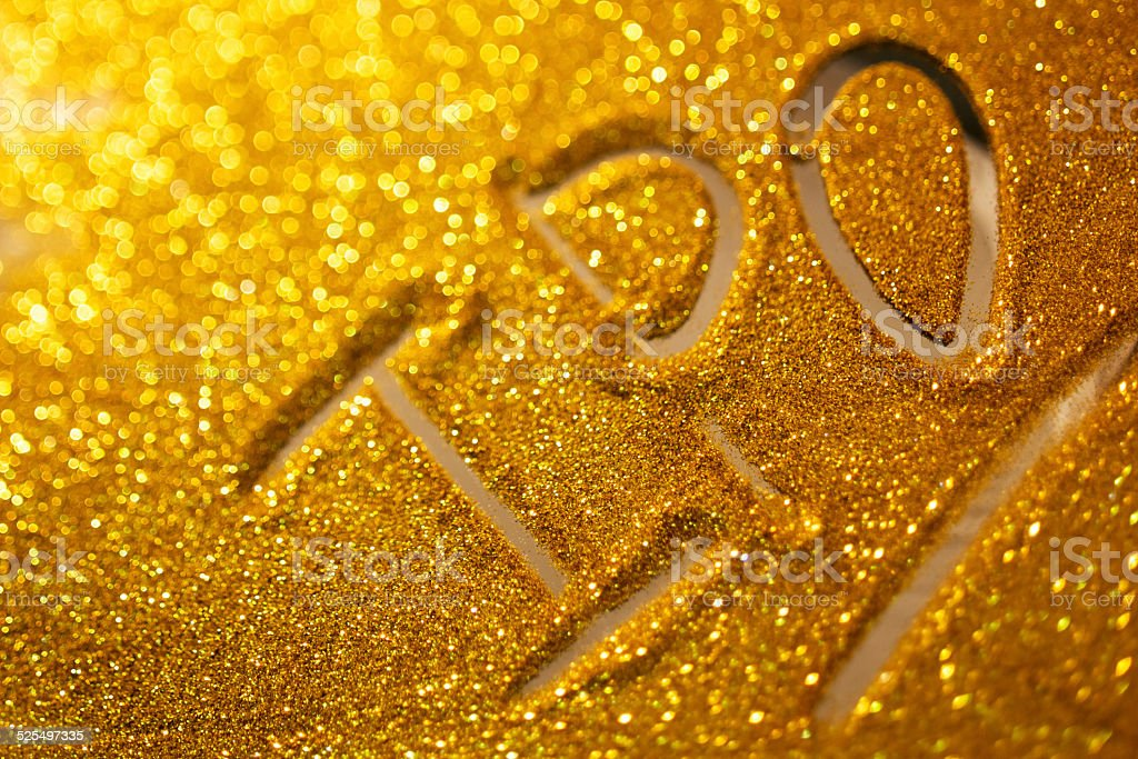 word IPO  writing on golden sand background stock photo