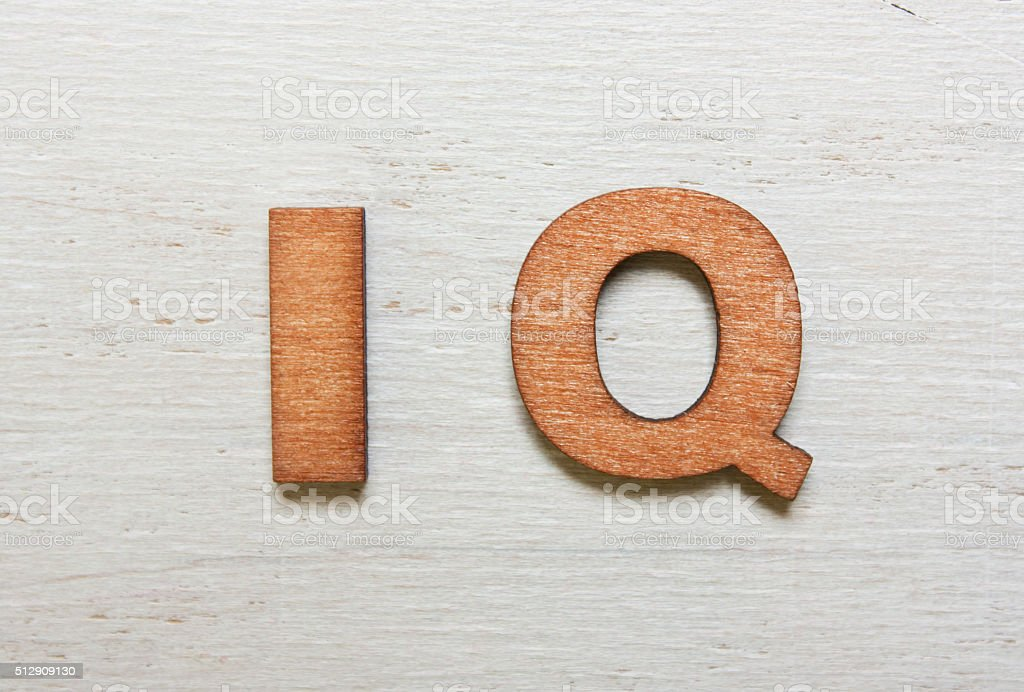 Word IQ (Intelligence quotient ) made with wooden letters stock photo