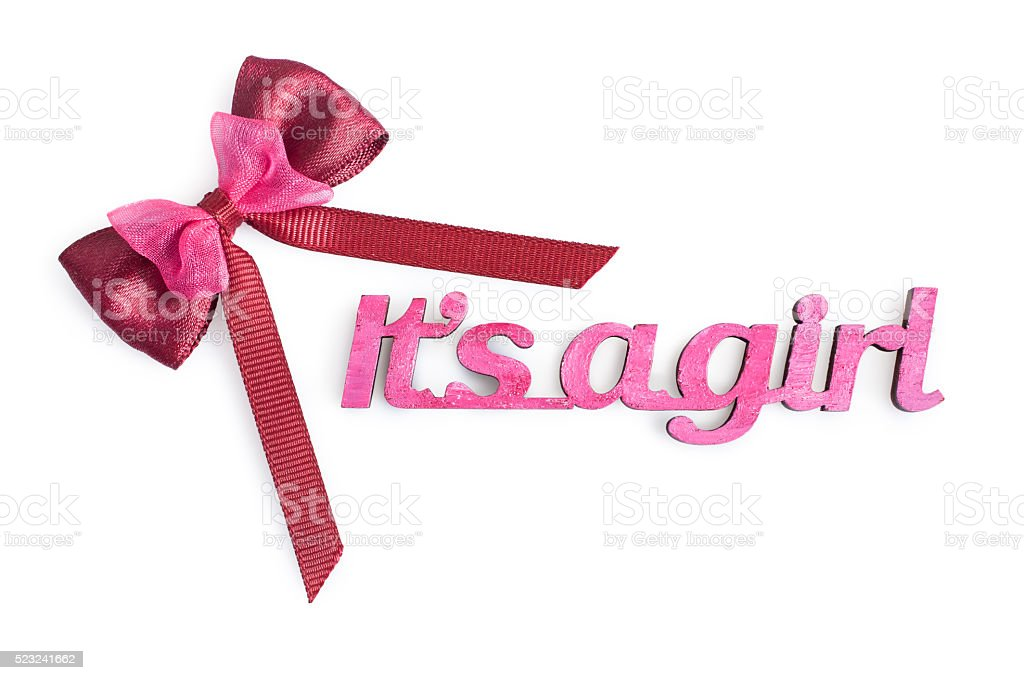 Word 'It's a girl' and ribbon stock photo