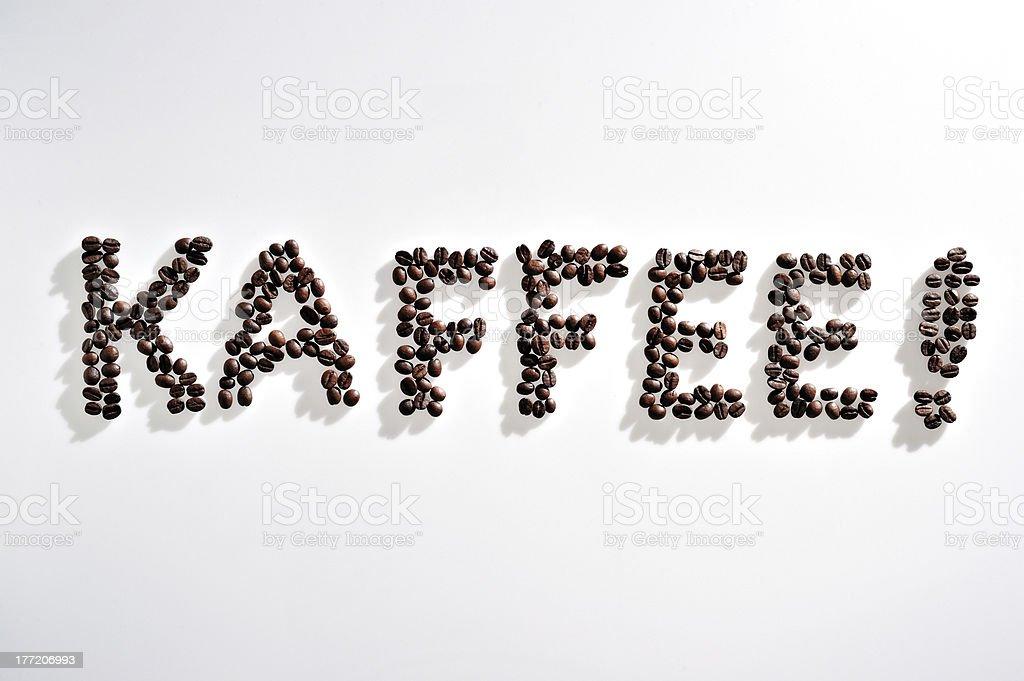 Word 'kaffee!' written in coffee beans royalty-free stock photo