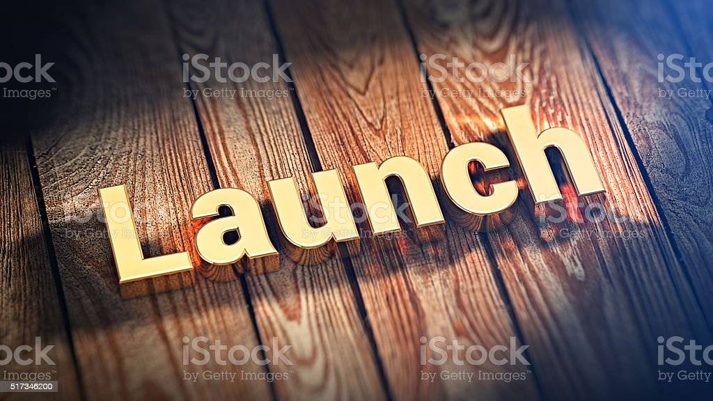 Word Launch on wood planks stock photo
