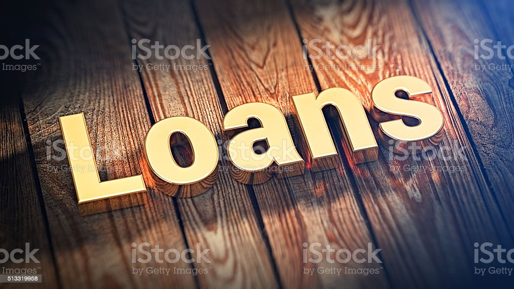 Word Loans on wood planks stock photo