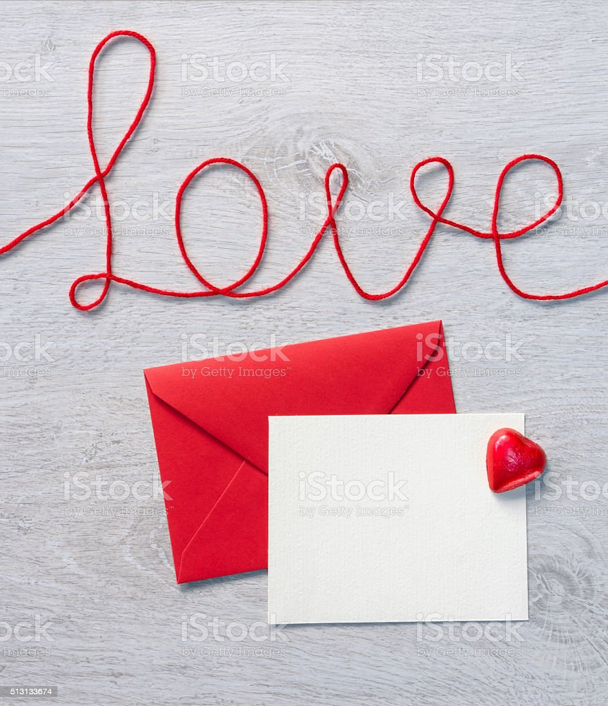 Word 'love' and red envelope with letter stock photo