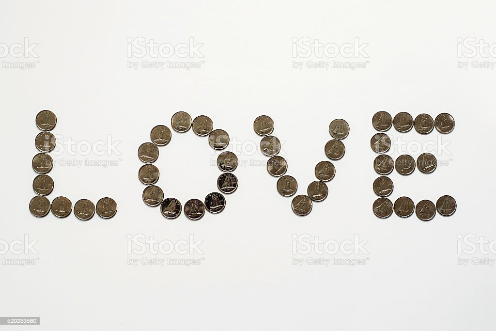 Word love in dimes stock photo