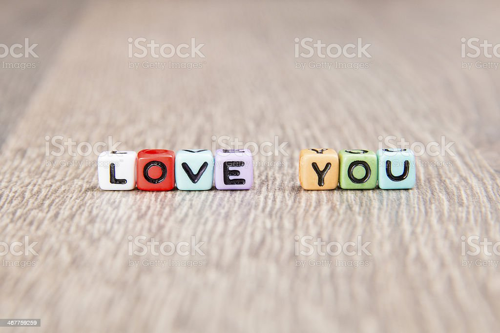 word love is built of colored cubes royalty-free stock photo
