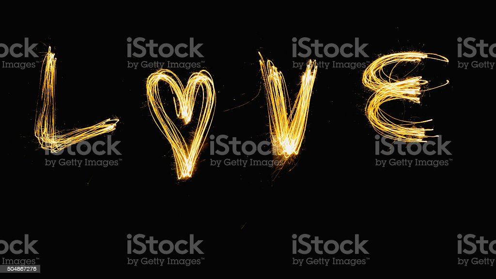 Word LOVE made by firework writing stock photo