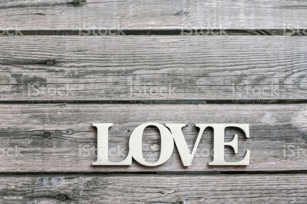 Word love over wooden background, top view stock photo