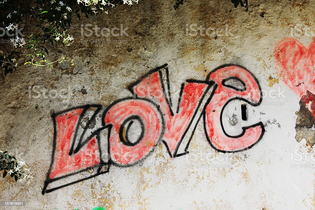 Word LOVE painted on old wall in Levanto, Liguria, Italy royalty-free stock photo