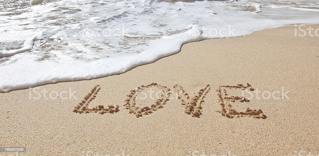 Word love the sea on beach in Valentine Day. royalty-free stock photo
