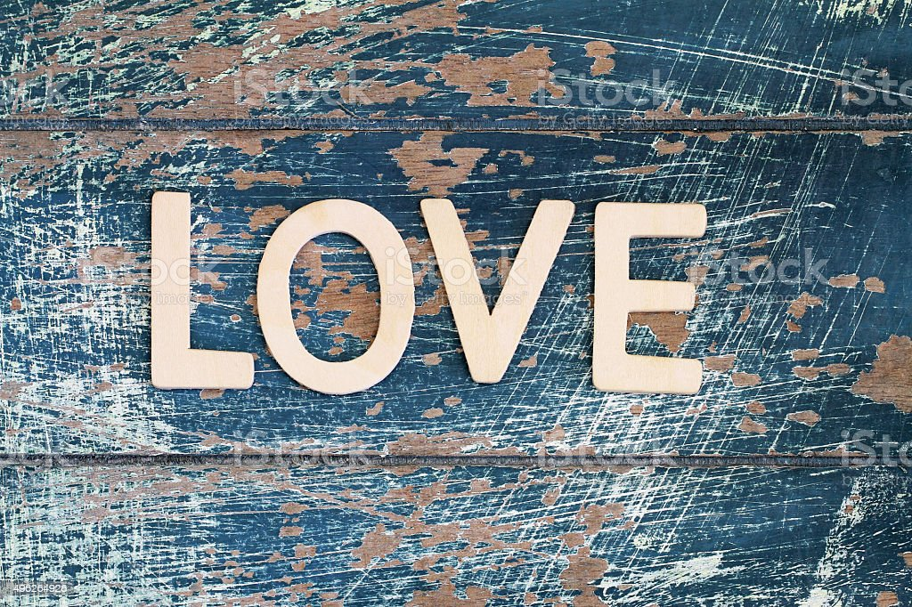 Word love written on rustic wooden surface stock photo