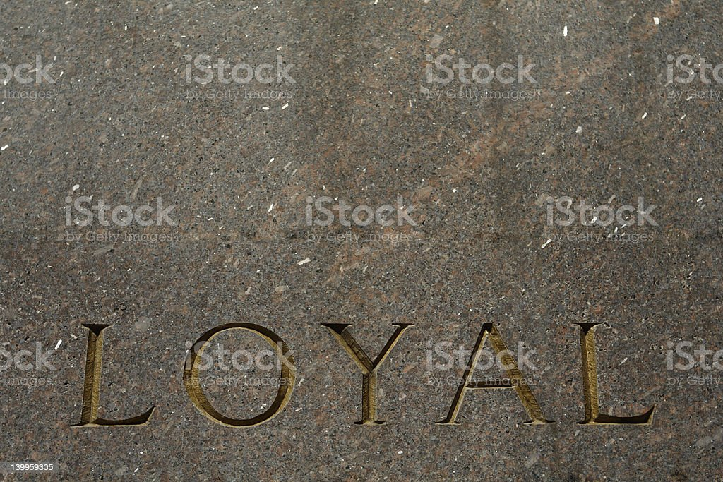 Word Loyal Carved in Gray Granite royalty-free stock photo