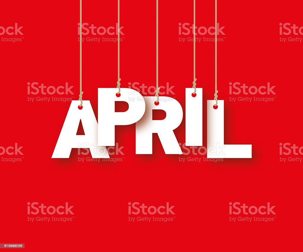 APRIL word of the white letters hanging on the ropes stock photo