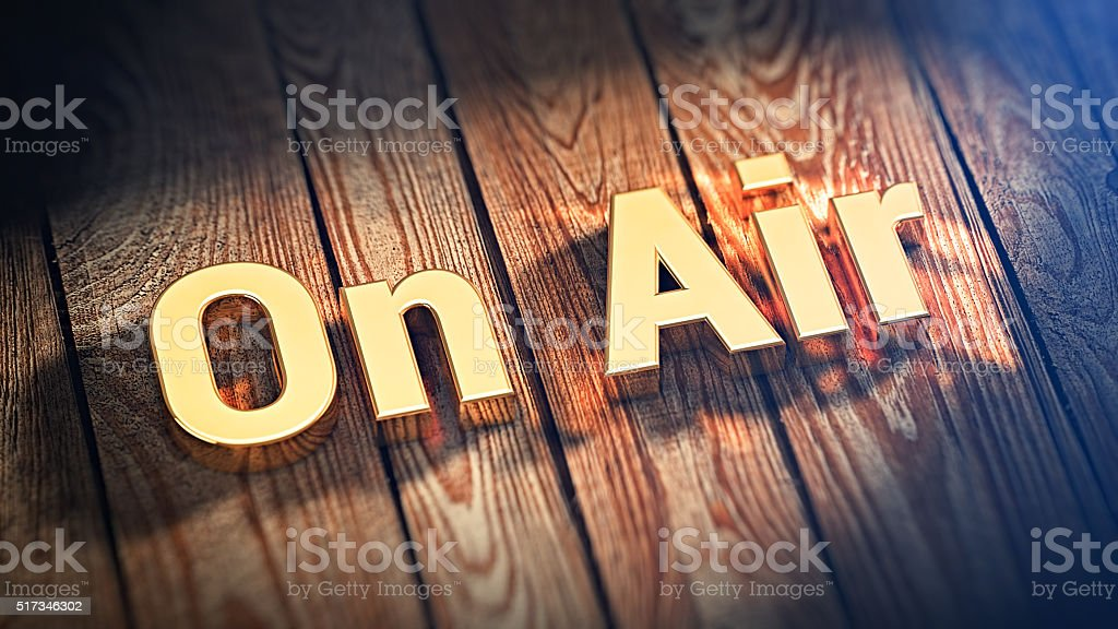 Word On Air on wood planks stock photo