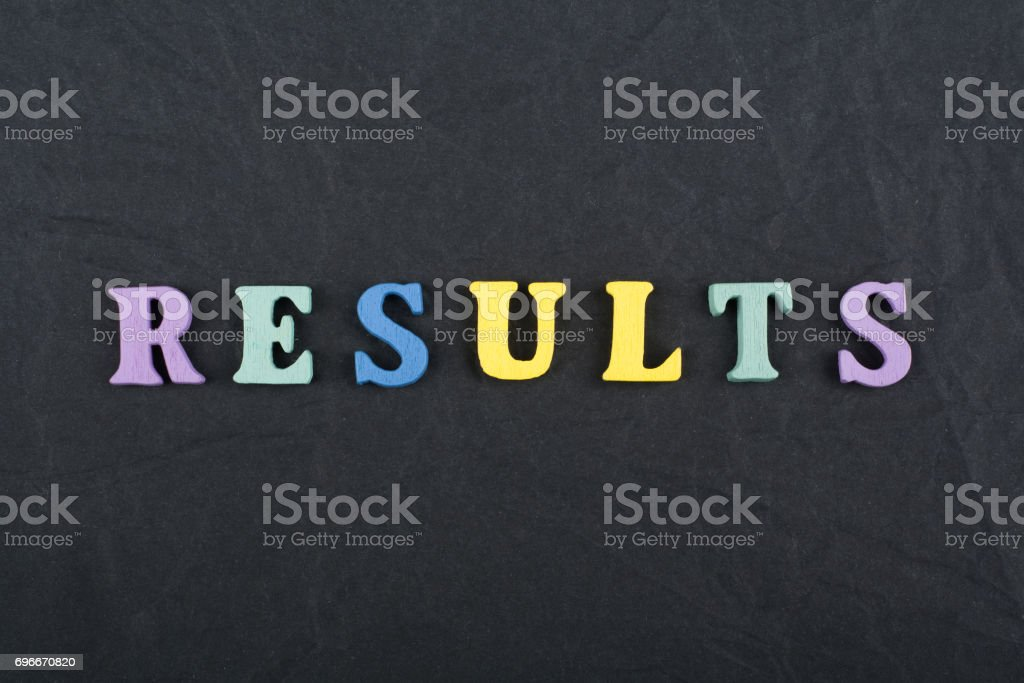 RESULTS word on black board background composed from colorful abc alphabet block wooden letters, copy space for ad text. Learning english concept stock photo