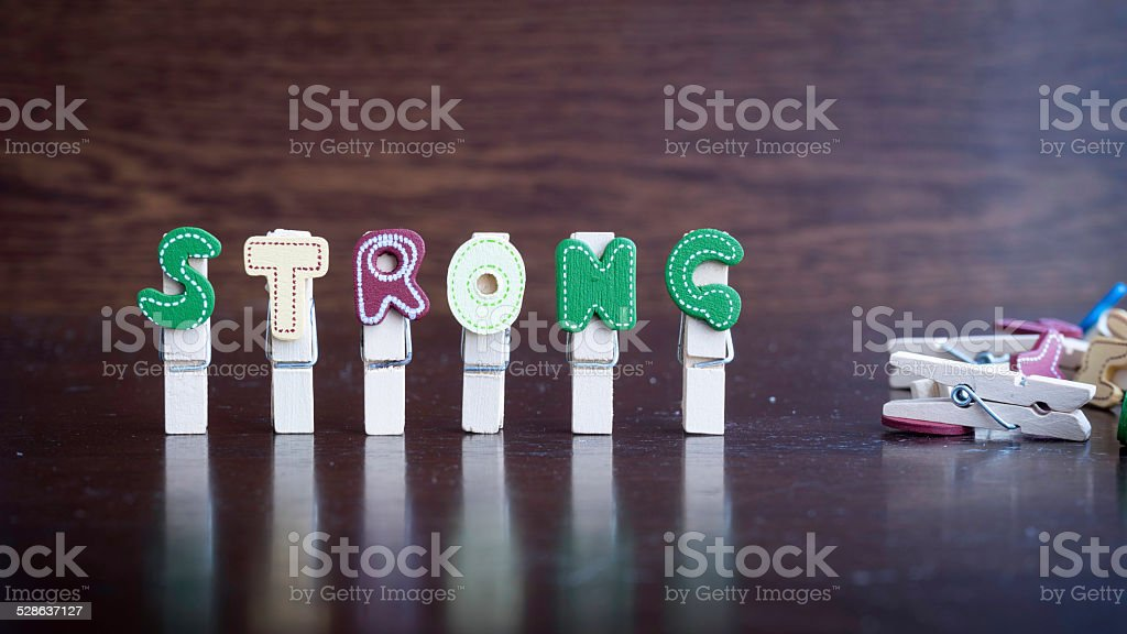 STRONG word on clothes peg stick stock photo