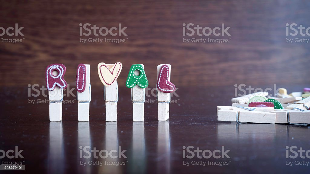 RIVAL word on clothes peg stick stock photo