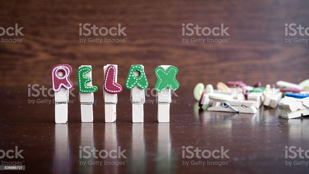 RELAX word on clothes peg stick stock photo